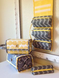 Rollie Pollie Organizer Bag Sewing Pattern.  The perfect travel organiser.  Love this for my vacations.  Hangs in the bathroom with all my cosmetics, toiletries, hair brushes etc. Made one for me, one for hubby. Really ingenious pattern, the way it all fits together.