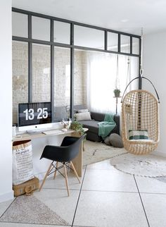Love the feeling of open space with the glass window dividing living room with workspace. Open, but still connected. And that hanging chair. | Juliana de Giacomi