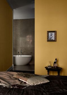In this large bedroom, golden ochre walls look sumptuous and elegant, creating a wonderfully warm and relaxing bedroom decor. Ochre Bedroom, Gold Bedroom, Large Bedroom, Mustard Bedroom, Mustard Walls, Cool Ideas, Bedroom Wall Colors, Bedroom Decor, Wall Decor