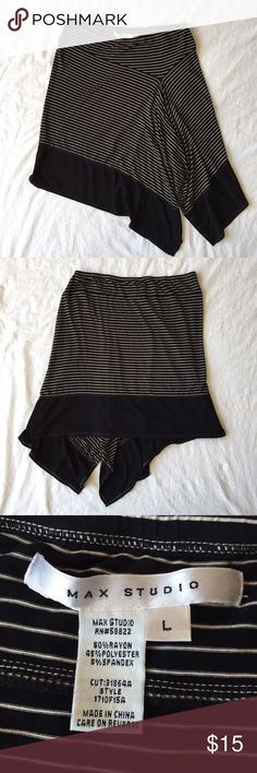 .Max Studio. Striped midi skirt with uneven hem Striped midi skirt with uneven hem. The top portion of the skirt has black and cream stripes. The bottom section is solid black. The uneven hem is longest in front at the left knee. This skirt could go from work to an evening out without taking a trip home to change! EUC. Max Studio Skirts Midi