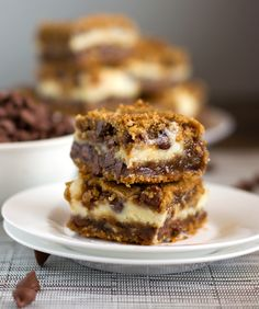Peanut butter chocolate chip cookie cheesecake bars. -→ I know it. The name is way too long. But I can't think straight or see straight or do anything normal right now, except I can see the fridge