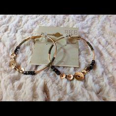 Buckle Hoop Earrings Gold hoops with pewter stone-like beads. Buckle Jewelry Earrings