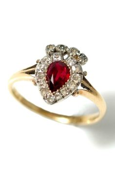 Trivette Antique Jewellery Victorian crowned heart ring with ruby centre and mine-cut diamonds.