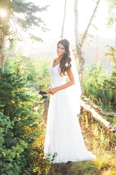 Modest wedding dress with sequin bodice and chiffon skirt.