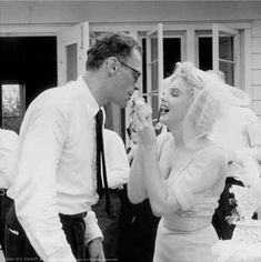 This photo of Marilyn Monroe feeding wedding cake to Arthur Miller at their reception is not an iconic image, and that's why I like it so much. The images from this reception are simple and warm, even if the press was in attendance. I love her cloud of a veil, and her demure-but-form-fitting dress is classic Marilyn. Plus she looks so very happy.