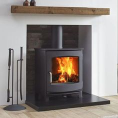 The Jens Keld 5 wood burning stove by Dik Geurts comes in two sizes; The Keld Low is a great addition to an existing fireplace chamber due to it's 'snug' structure and shallow depth. The Keld High raises the stove up by which allows Contemporary Wood Burning Stoves, Modern Stoves, Wood Burning Logs, Log Burning Stoves, Wood Burning Stove Insert, Wood Burner Fireplace, Wood Burning Fireplaces, Gas Stove Fireplace, Cosy Fireplace