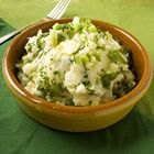 """Irish Champ - """"Looks similar to colcannon, but champ is native to the North of Ireland. It's made by blending scallions or green onions with creamy mashed potatoes. Great on its own, served steaming hot with extra butter which will melt through it. But it's also the perfect side dish for good quality sausages."""""""