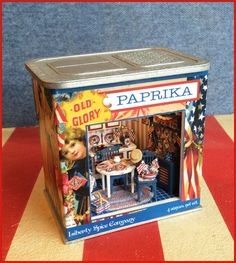 """1/4"""" Yankee Doodle Roombox This 1/4"""" scale kit coordinates with our Yankee Doodle holiday vignette kits. COLLECT THEM ALL! INCLUDES: Laser cut wood, electrical kit, wallpaper, flooring and all the artwork. Finished Size: approx 3 3/8"""" w x 2 5/16"""" d x 3 3/16"""" h. DOES NOT INCLUDE CONTENTS.  See our holiday vignette kits to fill your roombox!"""