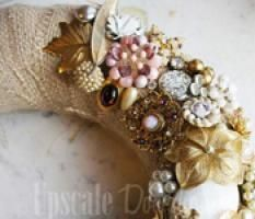 Have you ever wondered what to do with old costume jewelry? Or seen vintage jewelry at an estate sale or antique store and wished you had an occasion to make good use of it? Sarah Ives, Designer at Upscale Downhome has designed a welcoming wreath using interesting and unique pieces of antique jewelry. She shared this easy-to-follow tutorial on how to make a beautiful vintage jewelry wreath.  How to Make a Vintage Jewelry Wreath
