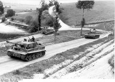 Tiger I heavy tanks of the German 1st SS Division Leibstandarte SS Adolf Hitler on a country road in Northern France, spring 1944, photo 2 of 2