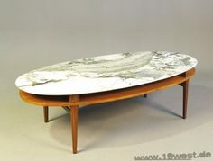 A teak / marble coffee table from the 1960's.