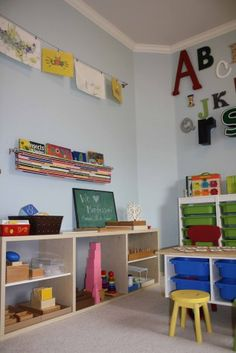 love the alphabet on the wall and the cloth book holder on the wall... maybe mount this below the white boards?
