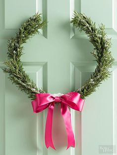 A classic wreath form, the laurel, gets a fragrant twist with fresh rosemary. Hot-glue the inner and outer rings of a 14-inch wooden quilting hoop together; let dry. Cut an 8-inch section from the top of the glued-together hoop. Use floristsl wire to attach rosemary bunches to the sides of the hoop and sprigs to the front. Glue a bow to the bottom center of the wreath; dust with faux snow if desired./