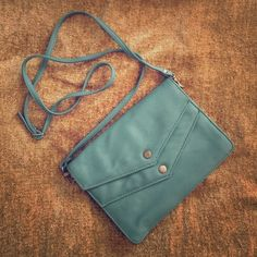 DEENA & OZZY envelope snap crossbody 2 envelope style snap closures. 1 interior zip pocket. 1 exterior zip pockets. Perfect to hold phone, keys, cash & a few small extras on a day or evening out! Brand new! Urban Outfitters Bags Crossbody Bags