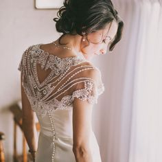 Beading on the wedding gown and decorations, on-trend for the 2014 elegant vintage trend.