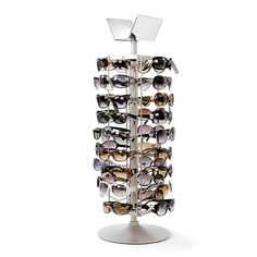 3e4e733d6882 Increase your sales by stocking sunglasses for travellers who forgot to  pack theirs! Space saving spinners hold 36 pairs of glasses. Great for  water parks