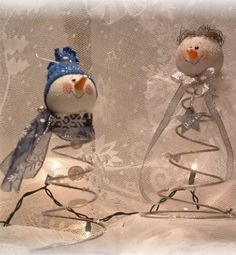 Snowmen on old bed spring. Using an old bulb or styrofoam ball for the head & glue cap for nose.