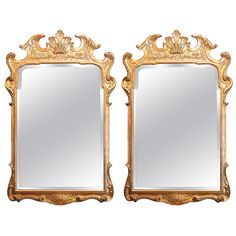 Pair of Gilt Mirrors with Low Key Carving on the Frame