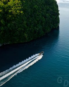 Aerial of the Rock Islands in the late afternoon, a boat returning from a dive trip Palau, Micronesia