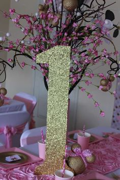 Glitter number at a pink and gold Minnie Mouse birthday party! See more party ideas at CatchMyParty.com!