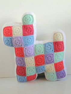 This crochet dog by Casey of Plus Three Crochet must be the best use of stashbusting granny squares I've ever seen!