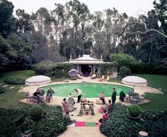 Slim Aarons's iconic photograph of the Pendletons entertaining guests beside the pool of their Beverly Hills home, circa 1960.