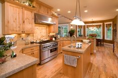 Beautiful light wood luxury kitchen design.  Check out 49 more high-end kitchen ideas at