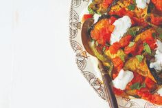 This version of the traditional Afghan dish banjan uses roasted eggplant rather than fried. Cooked eggplant, peppers and tomatoes are layered with creamy yogurt sauce, then garnished with fresh herbs. Roast Eggplant, Fire Roasted Tomatoes, Yogurt Sauce, Food Nutrition, Fresh Mint, Eat Right, Serving Size, Fresh Herbs, Food Photography