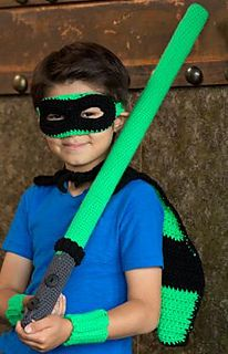 He can feel as powerful as an action hero in this crocheted costume set. We've included a cape, lightsaber, cuffs and mask. Star can be used to embellish the cape.