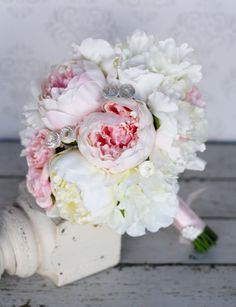 For sale is a gorgeous wedding bouquet with a fine mix of barely white, cream, and pink silk blend flowers; hand tied with the stems wrapped in pink