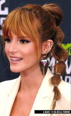 Bella Thorne - thick bangs with fringe to blend into hair