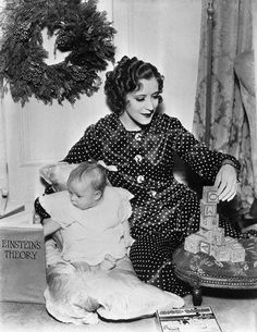 25 Jan 1935 — Burns and Allen Present. Their daughter Sandra Jean Burns, adopted daughter of George Burns and Gracie Allen buries her nose in a voluminous tome, while Gracie Allen finds herself intrigued by Sandra's playing blocks. — Image by © Bettmann/CORBIS