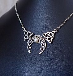 This simple piece is made with silver plated Celtic Triquetra knots and a Celtic crescent moon, featuring a high quality faceted acrylic rhinestone in your choice of color, and silver plated cable chain and findings.   eBay!