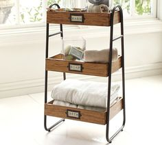 """If your style is vintage industrial, try re-purposing Pottery Barn's William Floor Storageas a 3-tray makeup container! Instead of """"WASH,"""" """"SOAP"""" and """"BATH"""" for your labels, try """"FACE,"""" """"HAIR,"""" and """"NAILS."""" Don't get us started on the perfume and lotion possibilities!"""