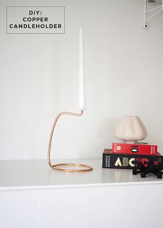 DIY: a copper mobile by the crafty sisters and this copper candle holder by Jennifer from an A Merry Mishap.