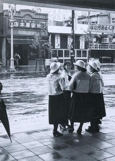 Schoolgirls and rain at Ginza, Tokyo, Japan - 1935 Source Twitter @oldpicture1900