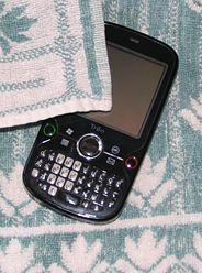 How to Save a Wet Cell Phone  Summary:  Remove battery  Remove SIM card & all other peripherals  Vacuum phone  DO NOT blow dry w/ dryer  Leave in open bowl of rice over night