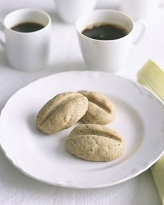 Espresso-Bean Shortbread: The perfect recipe to knock off Trader Joe's Kona Coffee Shortbread! Simply dip the cookies in melted white chocolate that has espresso grounds mixed in.