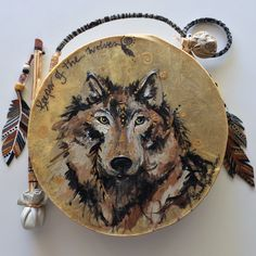 """***SOLD***  """"KEEPER OF THE WOLVES""""  ~  $ 164  ~  10inch primitive drum & beater ~ designed & hand-painted by artist:  Sharon Gilbertson  The drum is gone, but for """"Keeper of the Wolves"""" clothing collection - follow link on website to Sharon's VIDA VOICES shop.  Thank you."""