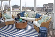 This outdoor space is colorful and comfortable.  Sarah shows how mixing stripes in complimenting colors can achieve a fun design and mixing in a few other pillows of varying scales ties the whole space together flawlessly.