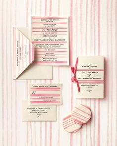 <43 of 56 >  Striped Invitation    If you've banned horizontal lines from your closet, it's time to reconsider: These invites positively own the classic French style. Each piece is hand-painted, and though the suite looks pretty here in raspberry, you can choose any shade under the sun.    Cynthia Warren Design