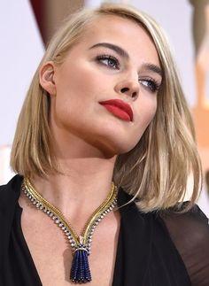 Margot Robbie's bold red lipstick and smoky eye makeup