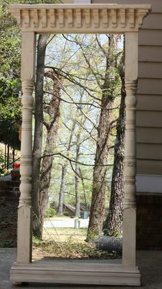 Antique door surround re-purposed as mirror - great