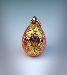 Antique Faberge Enamel Ruby Gold Egg Pendant circa 1900.   From a unique collection of vintage drop necklaces at https://www.1stdibs.com/jewelry/necklaces/drop-necklaces/