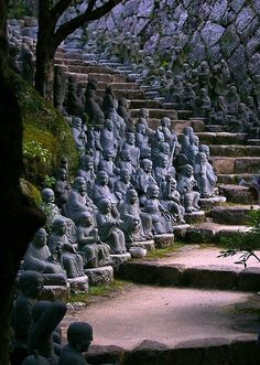 Miyajima Island (Japan) also known as 'Shrine Island' is filled with shrines and temples - this is part of the Buddhist temple called the Daisho-in Temple. 500 Rakan statues line the sidewalk (rakan means disciple and the 500 statues represent the 500 followers of the Buddha.)