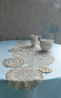 table runner made from doily assortment