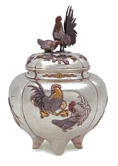 A silver, mixed metal and enamel koro (incense burner) By Masahide, Meiji period (late 19th century) The compressed lobed ovoid vessel set on four feet and decorated on the sides of the body with roosters, hens and chicks, a kingfisher and a heron in bold iroe takazogan, the neck decorated with cherry blossom scroll in colored enamels and gold wire, the domed cover with flower blossoms in iroe takazogan and applied with rooster and hen finial rendered in silver, copper and gold, silver liner