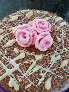 Birthday cake with marshmellow roses; chocolate drizzling