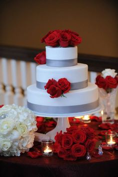 Red, white, and silver wedding cake with red roses and white roses. #weddingcake #redwedding. Beautiful <3