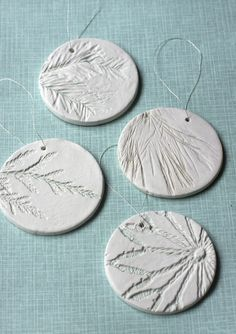 press natural objects into clay ornaments - cookie cutters